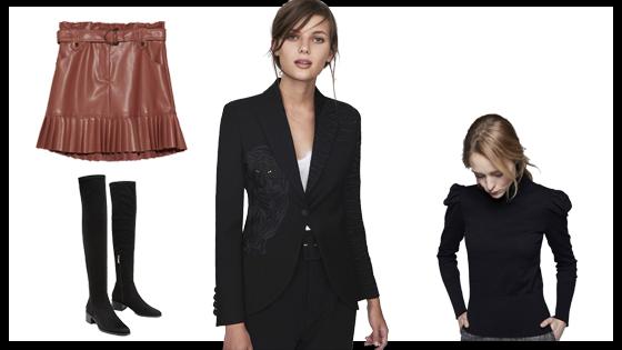 Blazer negra, falda rosa plisada, botas altas negras y jersey de cuello vuelto negro