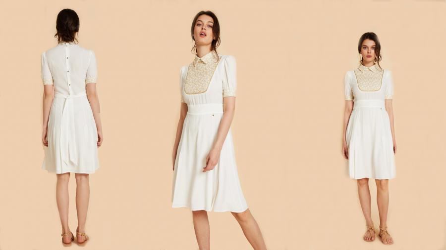 Vestido blanco con pechera bordada y lazada en la cintura de la colección de Pati Conde by Dandara